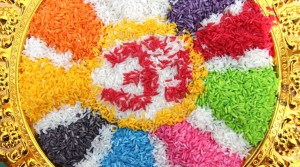 colorful hindu aum om symbol made from rice