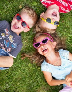 22306348-laughing-children-relaxing-during-summer-day